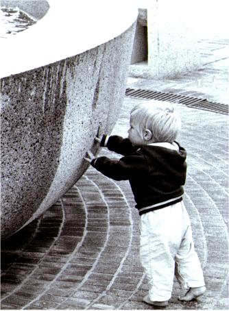 Small Boy touching Water Fountain in Custom House Plaza, Monterey, California 1970; Copy Righted 1970 &copy Bruce Perdue, All rights reserved