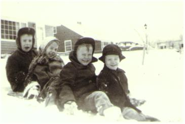Bill, Jeanne, Bob and Bruce in the snow at 831 Hayes Avenue Cuyahoga Falls, Ohio